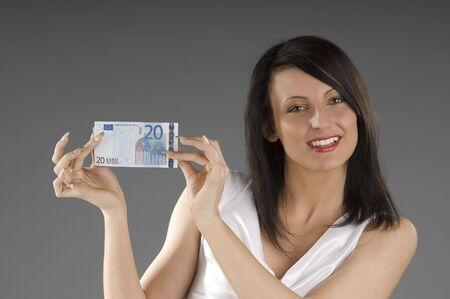 20 euro: young smiling brunette with 20 euro in her hands