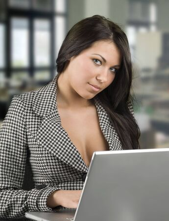 tailleur: sensual secretary in formal dress working at the computer