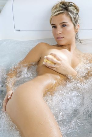 cute naked blond inside a bathtub relaxing herself Stock Photo - 2888672