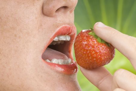 a red open mouth eating a strawberry fruit Stock Photo - 3083800