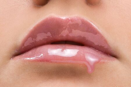 close up of a mouth with red lipstick dropping Stock Photo - 3083804