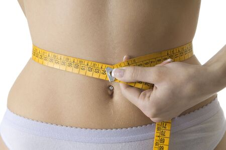 bulimia: close up of a female body measuring her waist LANG_EVOIMAGES