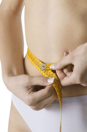 close up of a female body measuring her waist Stock Photo - 3083824