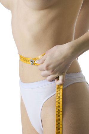 close up of a slim female body measuring her waist Stock Photo - 3083825