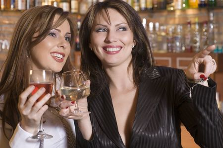 two young woman near a bar drinking and chatting each others Stock Photo - 3083870