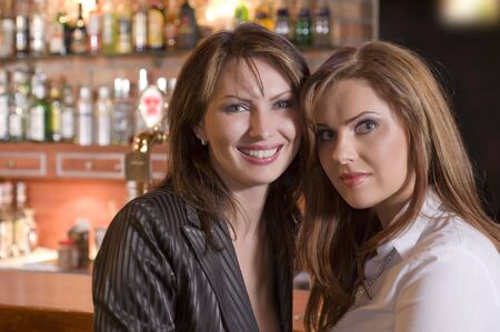 two nice and friendly woman near a bar face to face Stock Photo - 3083876