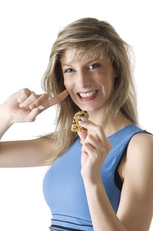 blond girl in blue chemise eating a diet tablet  Stock Photo - 3083962