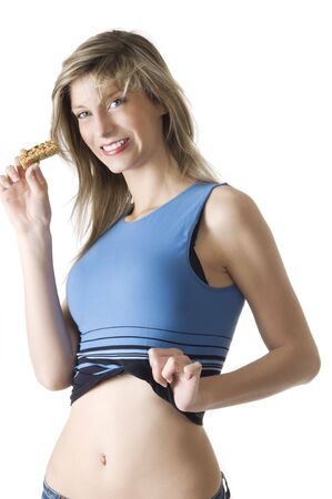 blond girl in blue chemise eating a diet tablet and smiling in camera Stock Photo - 3083963
