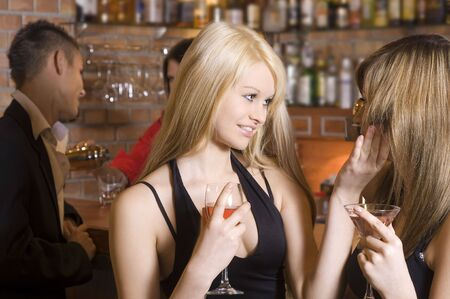two young girls chatting and drinking in a pub Stock Photo - 3307787
