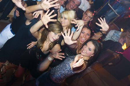 group of young people dancing and enjoying inside a night club Stock Photo - 3307788