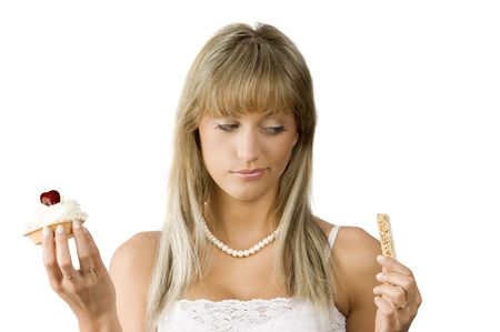 beautiful girl in hesitation to choose between sweet or diet food Stock Photo - 3307800