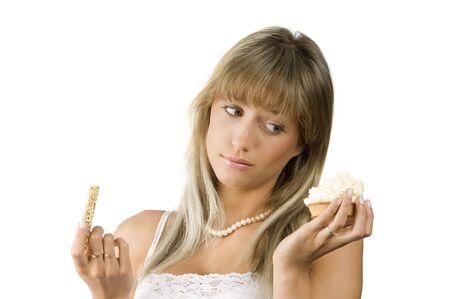 beautiful girl in hesitation to choose between sweet or diet food Stock Photo - 3430759