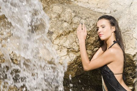 sensual portrait of a girl with hair and dress wet near a waterfall Stock Photo - 3430806