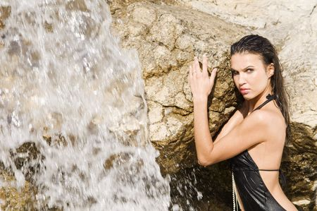 sensual portrait of a girl with hair and dress wet near a waterfall Stock Photo - 3430808