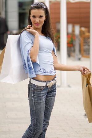 nice young woman outside of a pub with some shopping bags Stock Photo - 3258009