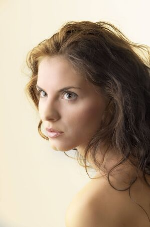 attractive portrait of a cute brunette with moved hair and strong look Stock Photo - 3348490