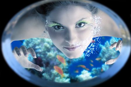 cute siren near a porthole of a ship under water looking inside  Stock Photo - 3348487