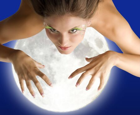 girl flying as in a dream trying to get with her hands the moon Stock Photo - 3348488