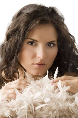 pretty girl in a sweet and soft portrait with feather near her face Stock Photo - 3304341