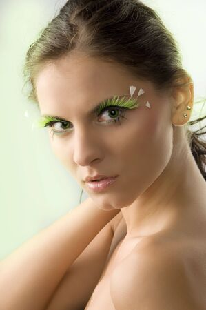 portrait of a young and cute woman with artificial green eyelashes and green eyes Stock Photo - 3304337