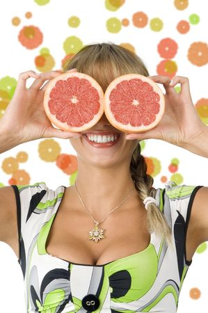nice blond girl with green dress using grapefruit as glasses Stock Photo - 3348693