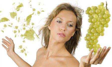 pretty and sensual blond girl with a big grape near and some flying leaves grape