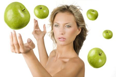 blond pretty girl with some green apple flying all around her as a planetarium
