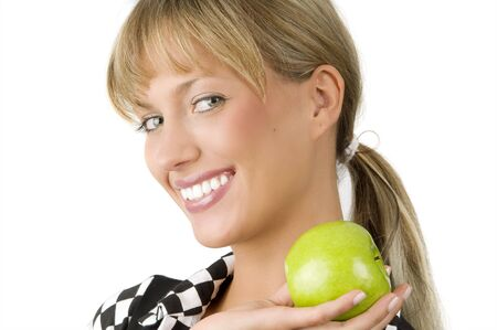 nice blond girl with a green apple on one hand with a great smile Stock Photo - 3330083