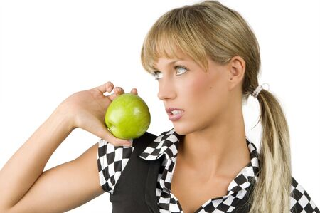 cute blond girl with a light green eyes looking away and keeping a green apple Stock Photo - 3330063