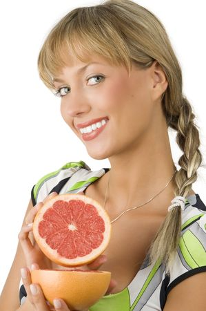 blond and cute girl with green dress showing grapefruit photo