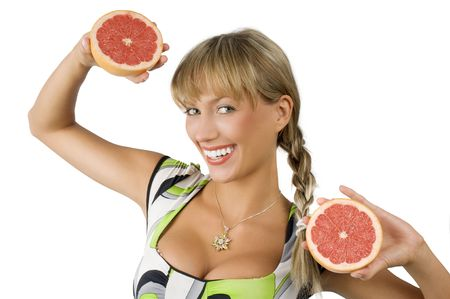 happy and smiling blon girl with green dress and two half grapefruit in hands photo