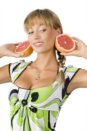 big earings of grapefruit on a nice and young woman with green dress photo