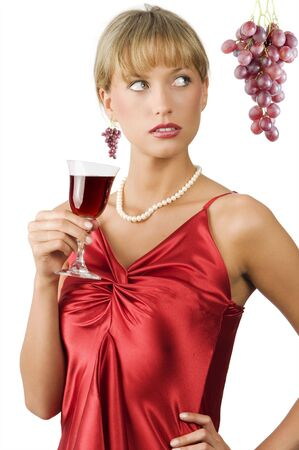 glancing: upscale or stylish lady in red dress with a glass of red wine with glancing eyes