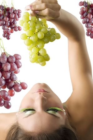 sexy food: girl with her head down keeping some green grape from top LANG_EVOIMAGES