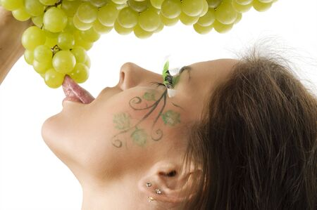 sexy brunette with a nice draw on her face licking green grape Stock Photo - 3465331