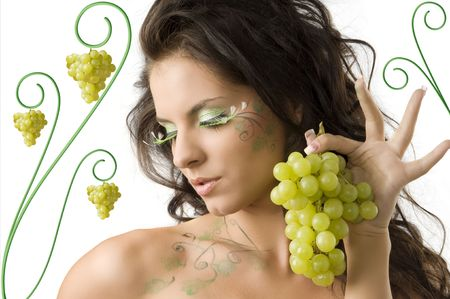 pretty girl with bodypaint on shoulder and face looking down with grape Stock Photo - 3465335