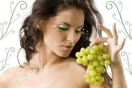 cute brunette with great green eylashes and some green grape Stock Photo - 3465328