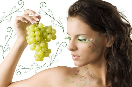 nice brunette with bodypaint and green eyelashes looking a grape  Stock Photo - 3465327