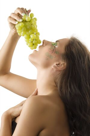 girl eating grape with a nice body paint with leaf on her face Stock Photo - 3468090
