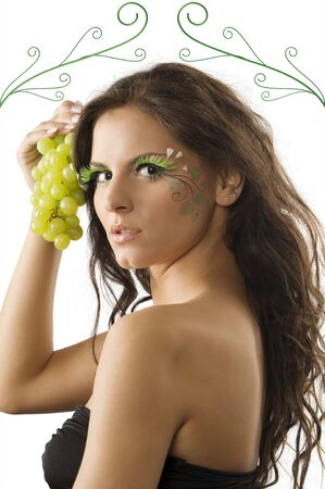 portrait of a cute brunette with bodypaint on her face keeping green grape near Stock Photo - 3468113