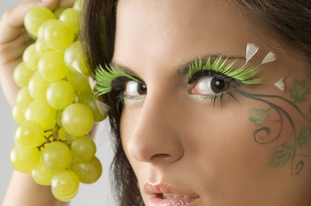 close up of the eyes of a cute brunette with artificial eyelashes and face painted Stock Photo - 3468094