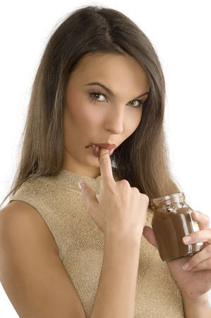 sensual girl sucking her finger with some chocolate cream on photo