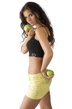 nice young woman with yellow short skirt and two green apple photo