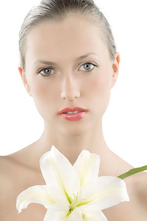 young and beautiful woman with a white lily and a skin like a doll Stock Photo - 3558121