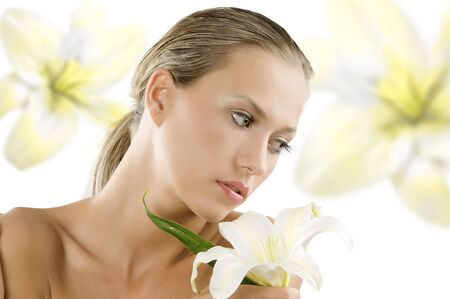 fresh young and beautiful woman with wet hair and a white lily Stock Photo - 3558142