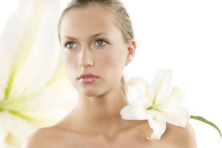 fresh portrait of a young and beautiful woman with a white lily Stock Photo - 3558153