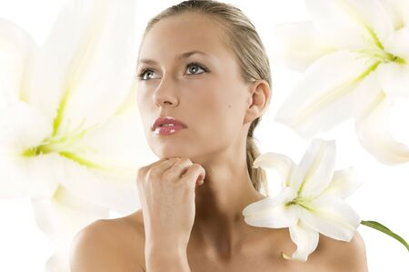 young woman with white lily on her shoulder looking up with eyes