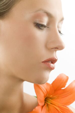 close up of a blond girl with an orange lily near the face Stock Photo - 3558149