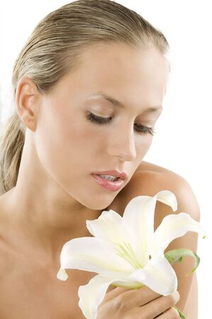 blond and beautiful girl with wet hair looking down a white lily Stock Photo - 3559543