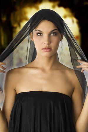 beautiful woman with a black veil on her head like black wife photo